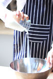 Pouring sugar for baking Royalty Free Stock Photography