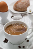 Pouring sugar on coffee cup. Royalty Free Stock Photos