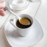 Pouring sugar on coffee cup. Stock Photography