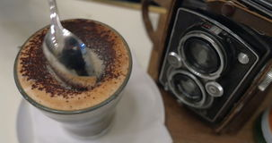 Pouring sugar in coffee and stirring up stock video