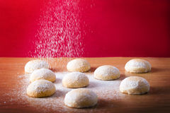 Pouring sugar on the kahk - Eid El Fitr Royalty Free Stock Photo