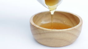 Pouring sweet honey for healthy ingredient stock video footage