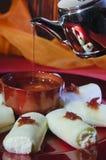 Pouring Syrup on Halawa Jubon, Arabic Sweets for Ramadan and Eid royalty free stock image