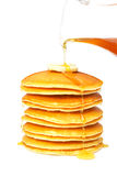 Pouring syrup on the pancakes Royalty Free Stock Photography