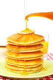 Pouring syrup on the pancakes stock photos