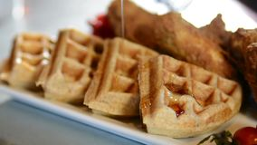 Pouring syrup on a waffle stock video footage