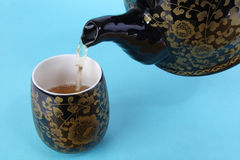 Pouring tea Stock Photo