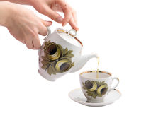 Pouring tea. In the cup Royalty Free Stock Photo