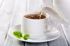 Pouring tea Stock Photos