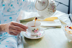 Pouring Tea:  Breakfast in Bed Stock Images