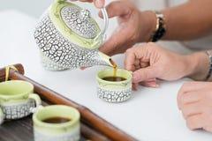 Pouring tea Royalty Free Stock Photo
