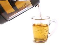 Pouring tea into a cup Stock Photos