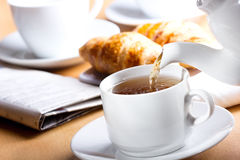 Pouring tea into cup Royalty Free Stock Photography