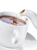Pouring tea into cup of tea Royalty Free Stock Images