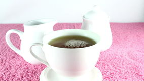 Pouring tea into cup stock video footage