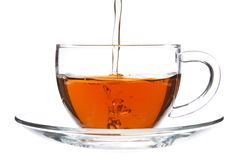 Pouring Tea into Glass Cup Royalty Free Stock Photography