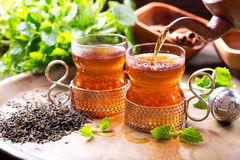 Pouring tea into glass Royalty Free Stock Images