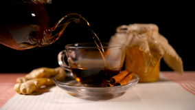 Pouring Tea with Honey, Ginger and Cinnamon stock video