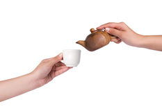Pouring tea over white background Stock Images
