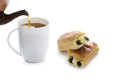 Pouring tea with pain au chocolat Stock Photo