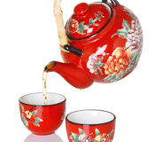 Pouring Tea From Red Teapot Stock Images