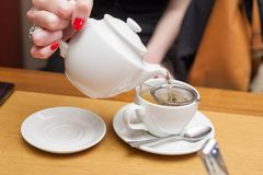 Pouring tea table Royalty Free Stock Images