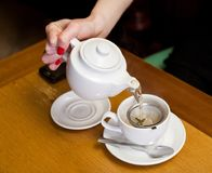 Pouring tea on table Royalty Free Stock Photos