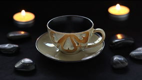 Pouring tea into tea cup in spa setting. stock video footage