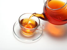 Pouring tea to a teacup Royalty Free Stock Image