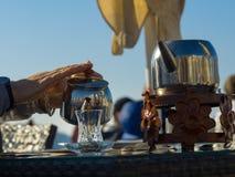 Pouring tea to a turkish tea glass. From double turkish tea pot Stock Photos