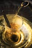 Pouring tea Stock Photos