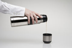 Pouring thermos' mug Stock Photos