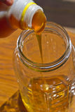 Pouring Thick Honey Stock Photography