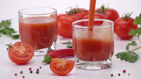 Pouring Tomato Juice Into Glass. stock video footage