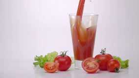 Pouring Tomato Juice Into Glass. stock footage