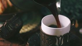 Pouring turkish coffee stock video footage