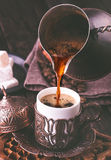 Pouring turkish coffee Stock Images