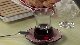 Pouring Turkish Tea into Glass. Pouring authentic Turkish tea into glass stock footage