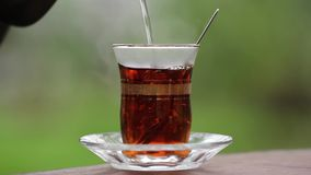 Pouring Turkish Tea to Tea Glass close up stock video