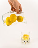 Pouring unsqueezed lemonade Stock Photo