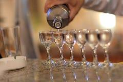Pouring the vodka Stock Photo