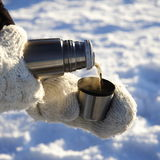 Pouring warm drink outdoors Royalty Free Stock Photo