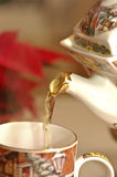 Pouring warm tea in a cup Stock Image