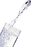 Pouring water Stock Images