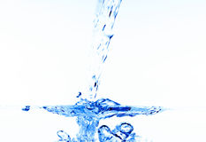Pouring water Stock Image