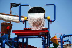 Pouring water. Water pouring out of a huge bucket royalty free stock images