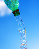 Pouring water from bottle Stock Photos