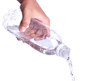 Pouring water from a bottle Royalty Free Stock Images