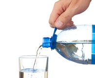 Pouring water from a bottle into a glass Royalty Free Stock Photo