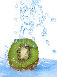 Pouring water on a clice of kiwi Royalty Free Stock Photo